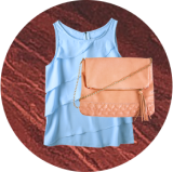 Blue top and peach purse overlayed on dark hardwood background